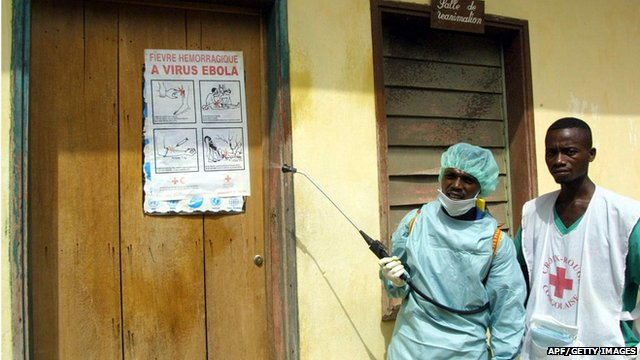 International Red Cross workers spraying disinfectant