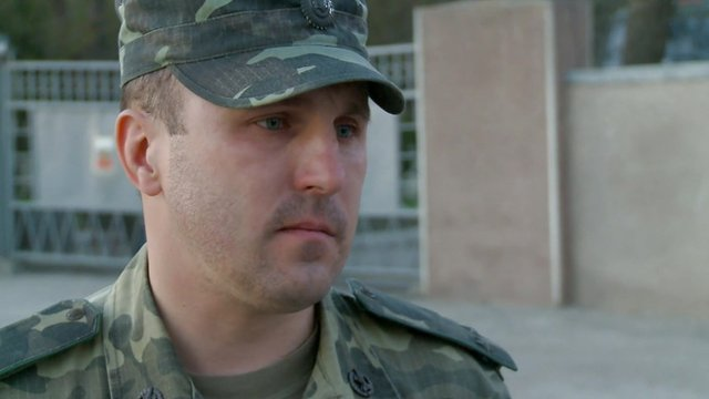 A member of the military at the Ukrainian air base in Evpatoria