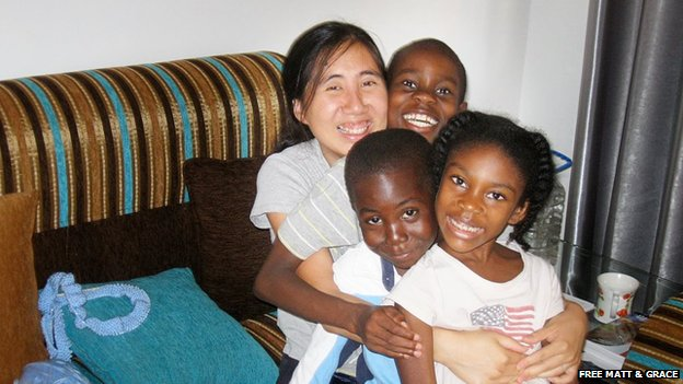 Undated photograph of Grace Huang with her three children, including Gloria