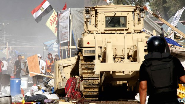 Security forces clear pro-Morsi protesters from a square near Cairo's Rabba al-Adawiya mosque on 14 August 2014