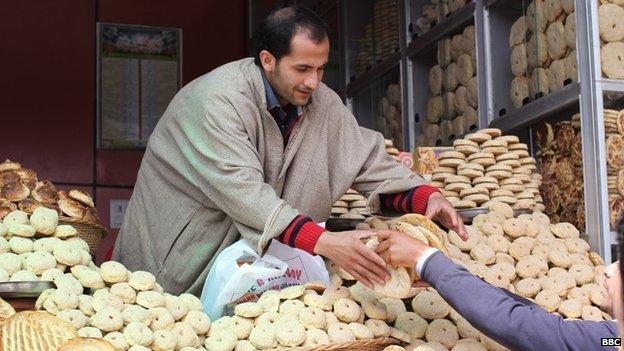 A man sells bread from his stall in Bijbehara, Kashmir