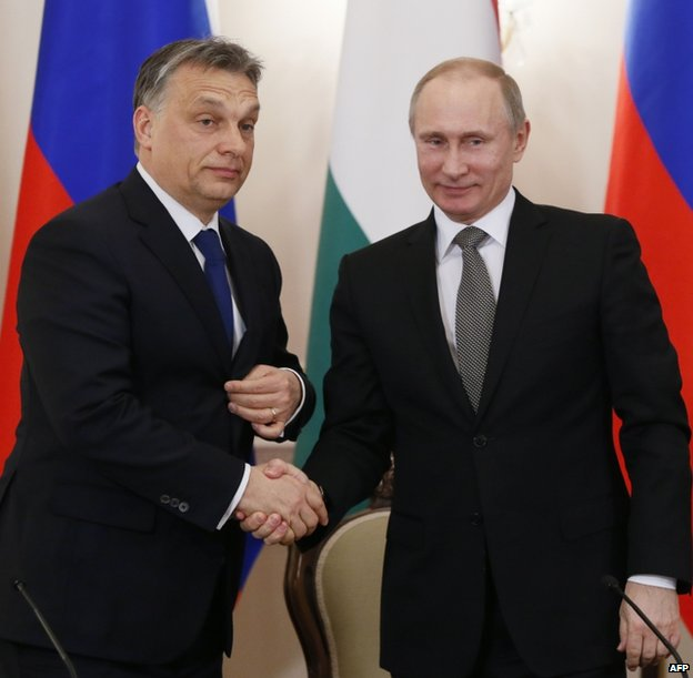 Hungarian Prime Minister Viktor Orban (left) shaking hands with Russian President Vladimir Putin, 14 January