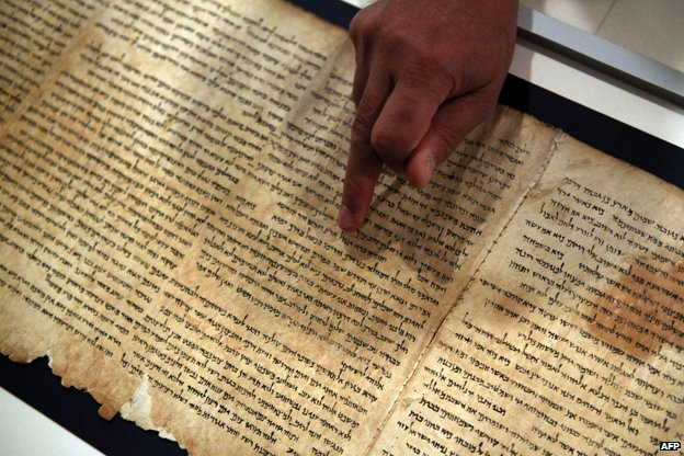 Dr. Adolfo Roitman, curator of the Dead Sea Scrolls and head of the Shrine of the Book points at the original Isaiah scroll found in Qumaran caves in the Judean Desert