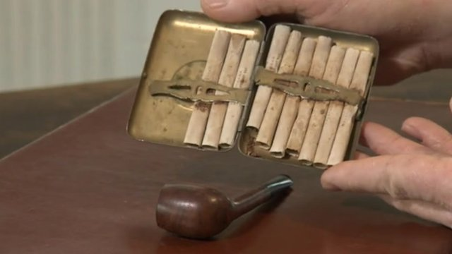 Soldier's half-smoked pipe and 10 hand-rolled cigarettes