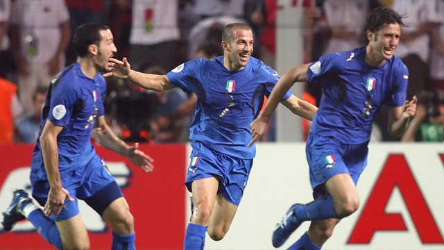 Italy celebrate after Fabio Grosso scores against Germany