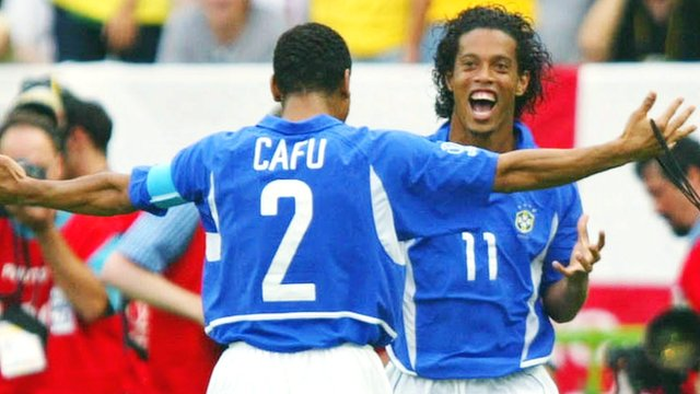 Ronaldinho celebrates after scoring for Brazil against England