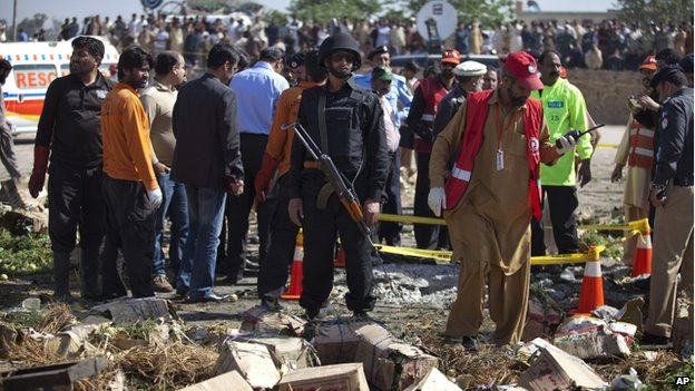 Police cordon off the area of a blast in Islamabad, Pakistan, on 9 April 9 2014