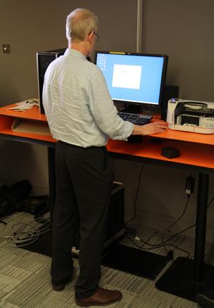 Chris Bowlby at desk