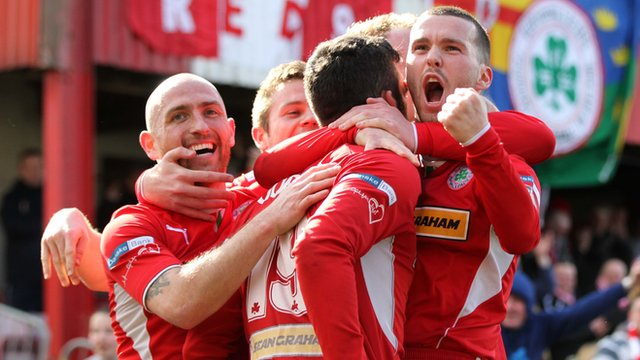Cliftonville players celebrate with goal scorer Joe Gormley