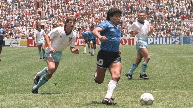 Diego Maradona powers through the England defence to score for Argentina
