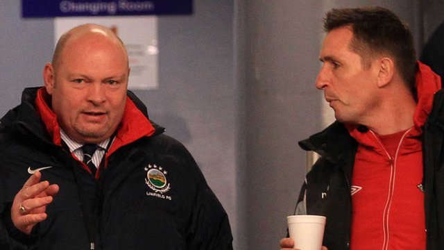 Linfield manager David Jeffrey and Stephen Baxter of Crusaders