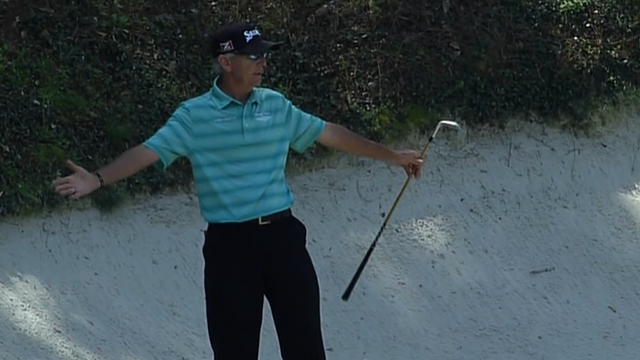 Former Masters champion Larry Mize holes a bunker shot