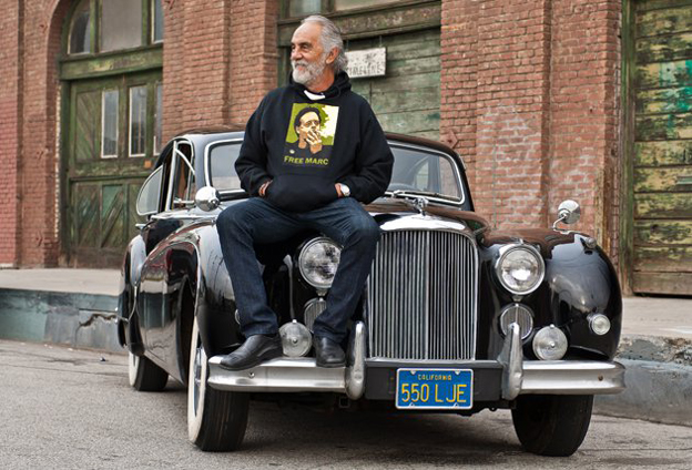 Tommy Chong sitting on his Jag