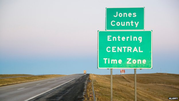 Signpost between Jones and Jackson county, South Dakota, marking the start of the central time zone