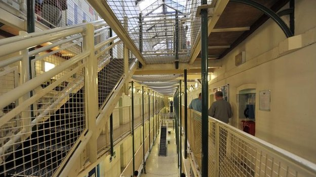 Prisoners in a cell block at Wormwood Scrubs, a Category B prison in London