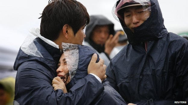 Family members of passengers missing on the overturned South Korean ferry