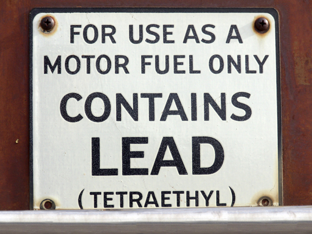 """Sign: """"For use as a motor fuel only, contains lead (tetraethyl)"""""""