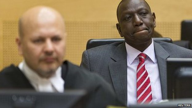 Kenya's Deputy President William Ruto (R) reacts as he sits in the courtroom before his trial at the International Criminal Court in The Hague (10 September 2013)