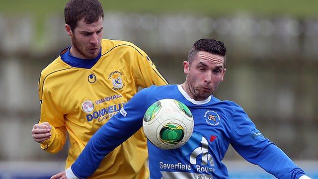 Match action from Ballinamallard United against Dungannon Swifts