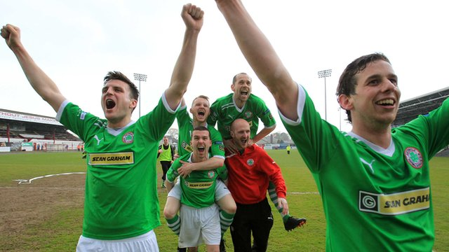Cliftonville players celebrate retaining the Gibson Cup