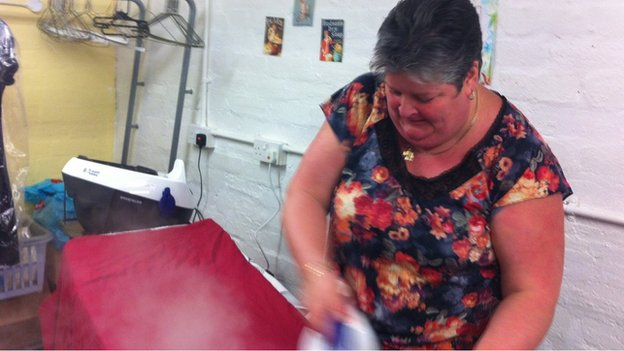 Jacqueline Crawley ironing in the Provanmill laundry