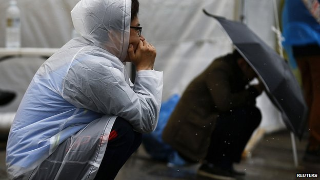 Relatives wait for news at Jindo harbour. 27 April 2014