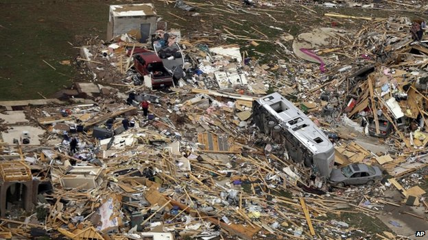 A travel trailer sits in the rubble of a house in Mayflower, Arkansas, 28 April 2014