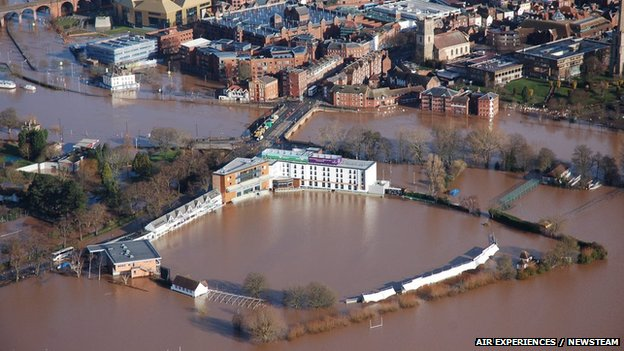 Worcestershire County Cricket Club surrounded by water.