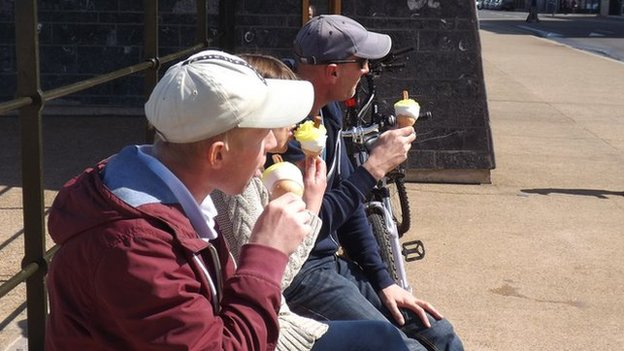 Visitors to Redcar enjoy a lemon top on the seafront
