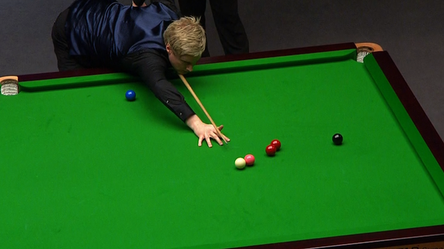 World number one Neil Robertson uses a trick shot to escape a snooker