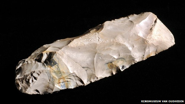 National Museum of Antiquities curator Luc Amkreutz identified this flint tool as a Mesolithic tranchet axe - the first such find from the North Sea. It was found by a Dutch fisherman in 1988