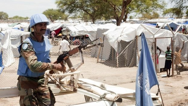 A United Nations peacekeeper keeps guard outside the Bor camp for the internally displaced in Bor town Jonglei state, South Sudan, on 29 April 2014