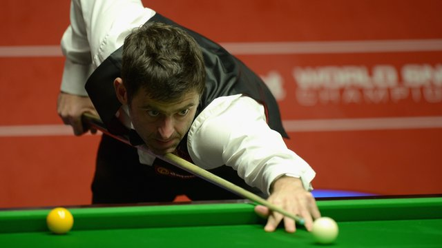 Ronnie O'Sullivan in semi-final action against Barry Hawkins at the World Snooker Championship