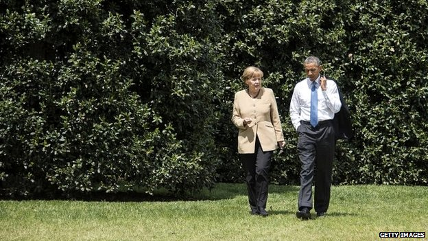 German Chancellor Angela Merkel and US President Barack Obama chat as they walk on the White House grounds - 2 May 2014
