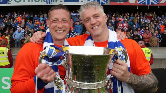 Glenavon captain Kris Lindsay with team-mate William Murphy