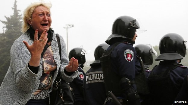 Woman reacting outside the burned out trade union building in Odessa, 3 May 2014