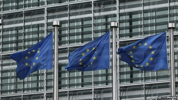 European Union flags outside the EU Commission building in Brussels