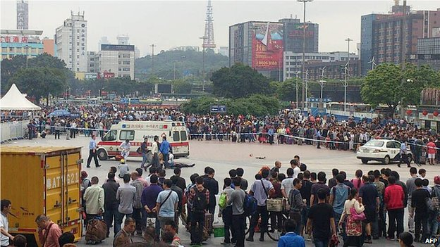 Medical personnel attend to the injured at the scene of a knife attack on the square of Guangzhou railway station in Guangzhou, in southern China's Guangdong province on 6 May 2014