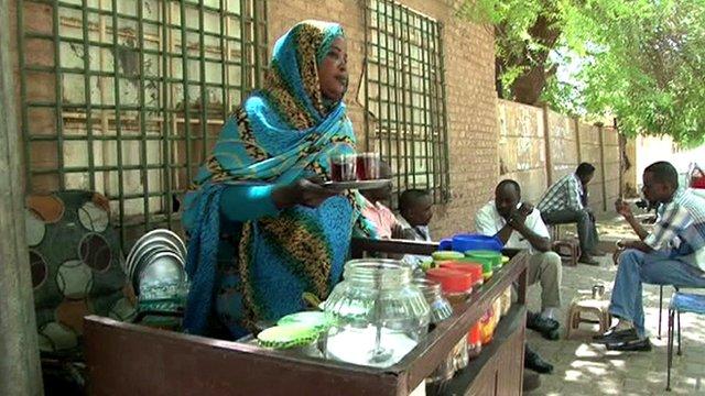 A Sudanese tea lady selling tea on the street