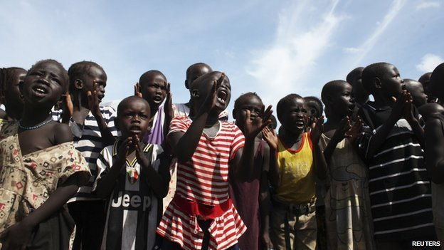 Children sing slogans against South Sudan's President Salva Kiir in an IDP (internally displaced persons) camp in the United Nations Mission In South Sudan base in Juba on 6 May 2014