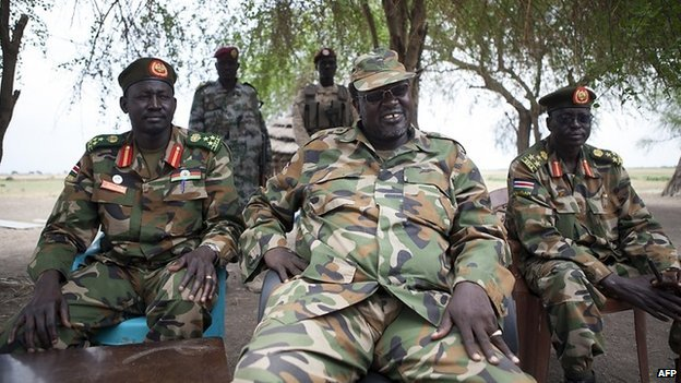 South Sudanese rebel leader and former vice president Riek Machar (C) attends an interview in Nasir on 14 April 2014