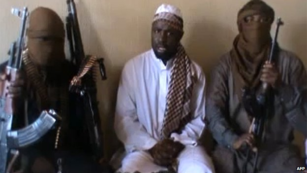 A screengrab taken from a video released on You Tube on April 12, 2012 apparently shows Boko Haram leader Abubakar Shekau (C) sitting flanked by militants