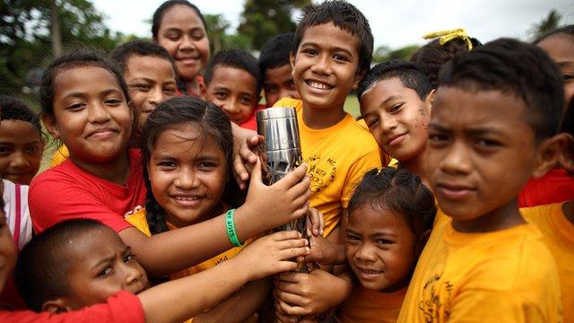 Queen's baton held by children in Tonga