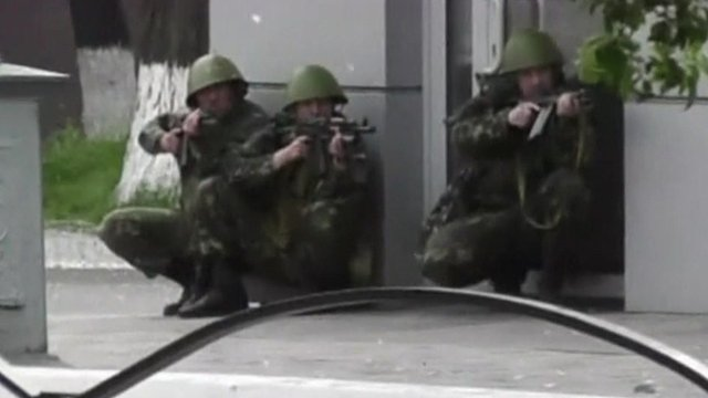 Uniformed men with weapons