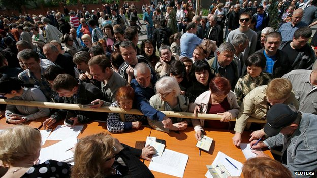Voters at a polling station in Mariupol, eastern Ukraine (11 May)