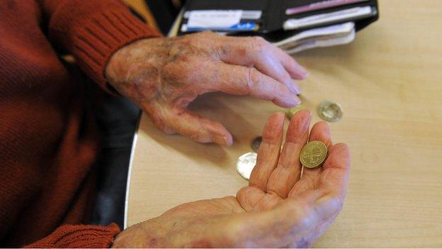 Pensioner handling money