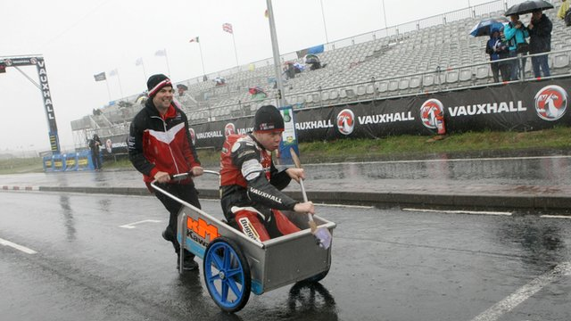 Jamie Hamilton with an improvised canoe and paddle at the rain-hit 2013 North West 200