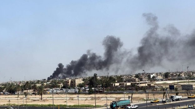 Smoke rises from Baghdad's Sadr City district after a car bombing on 13 May 2014