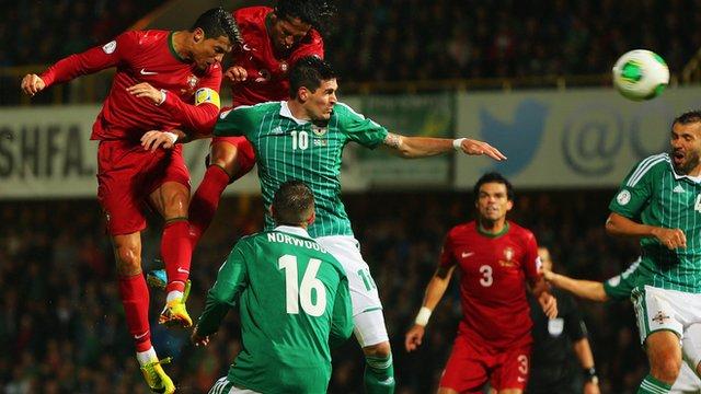 Portugal's Cristiano Ronaldo scores against Northern Ireland