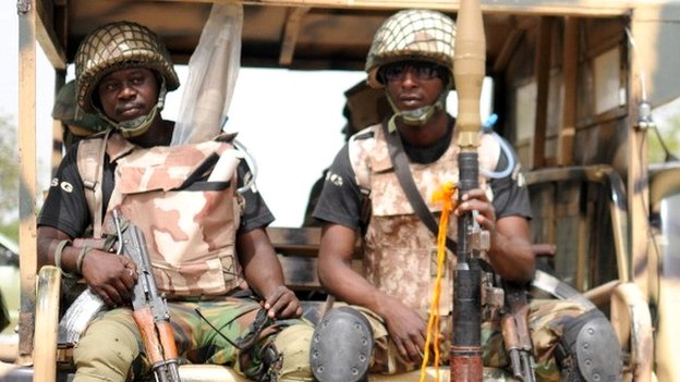 Nigerian soldiers ready for a patrol in the north of Borno state on 5 June 2013 in Maiduguri